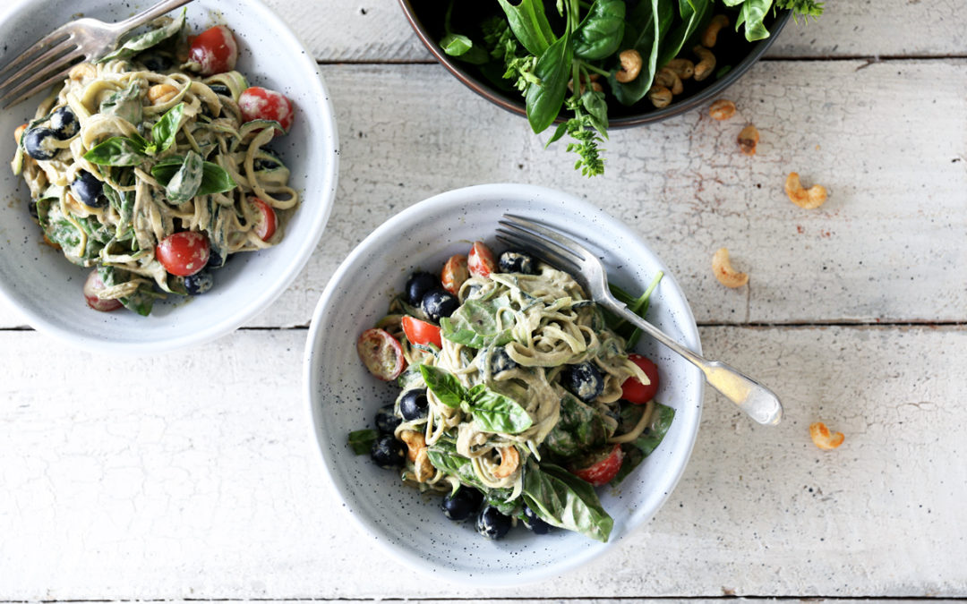 Raw Basil Zoodles with Black Olives, Tomatoes and Spicy Cashews
