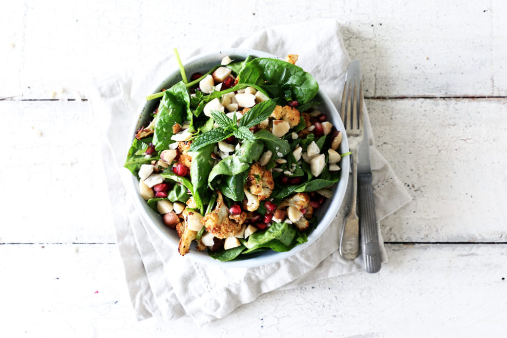 Spiced Cauliflower and Spinach Salad with Brazil Nuts and Pomegranate