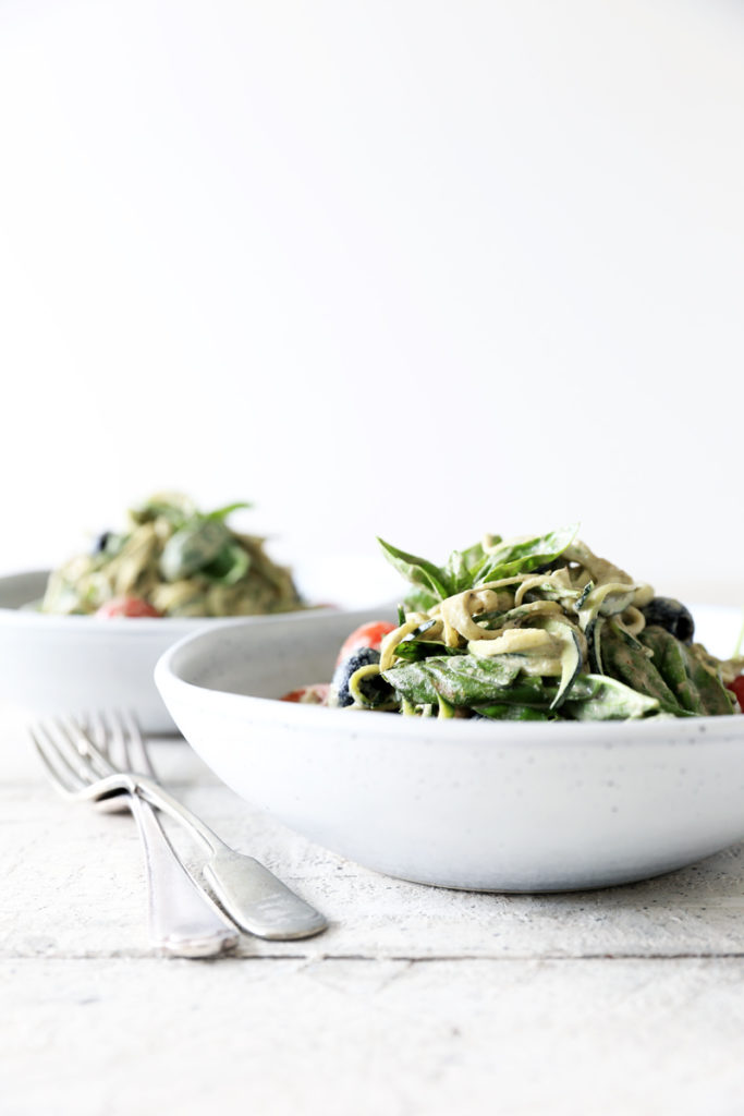 Raw Basil Zoodles with Black Olives, Tomatoes & Spicy Cashews