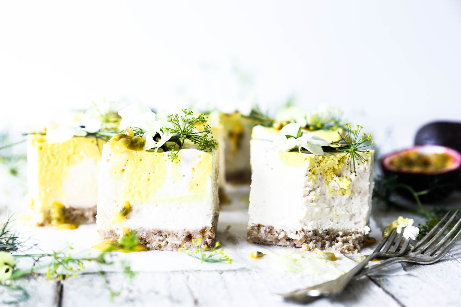 Mango and passionfruit coconut yoghurt cheesecake